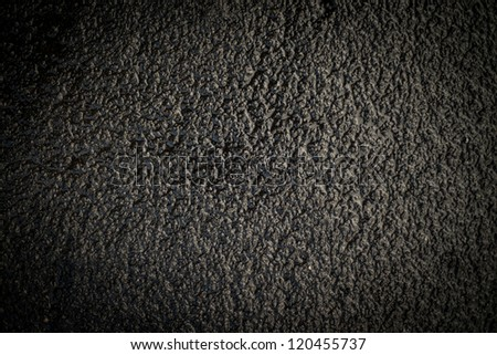 Dark black wet slippery asphalt to be used as texture or background