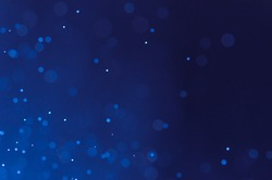 Dark blue abstract backgrounds with bokeh.
