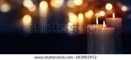 Dark blue background with burning candles and golden bokeh for a solemn occasion #683883952
