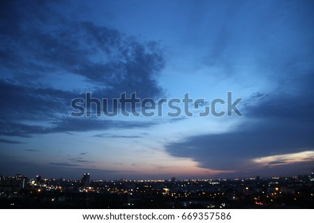 Photo of  dark blue cloud with white light sky background and city light midnight evening time