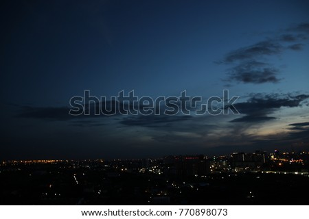 dark blue cloud with white light sky background and city light midnight evening time #770898073