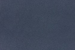 Dark blue fabric background texture. Detail of linen textile material.
