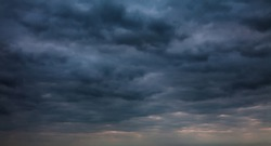 Dark blue Gloomy sky with stormy clouds before rain. Panoramic Nature Dramatic Sky Background, texture for Design. Wide Angle Artistic Wallpaper or Web banner With Copy Space
