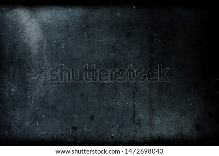 Dark blue grunge scratched obsolete background, old film effect, distressed scary texture with black frame #1472698043