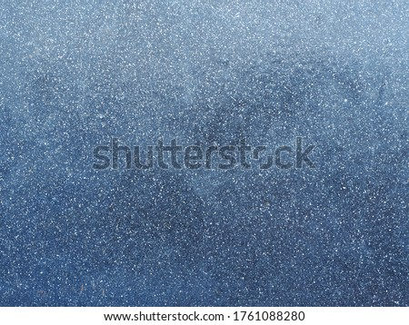 Photo of  dark blue metal surface of the wall with white flecks. Metallic blue background