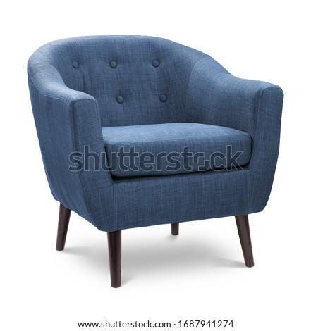 Dark blue navy sapphire color armchair. Modern designer chair on white background. Textile chair.