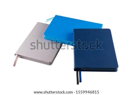 Dark blue notebook, grey notebook and blue notebook #1559946815