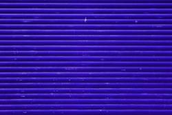 Dark blue purplish dirty garage door urban texture background