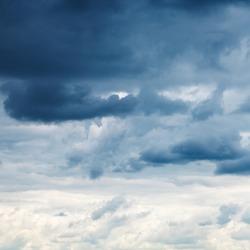dark blue rainy clouds in overcast sky in summer