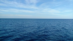Dark blue sea and light blue sky.