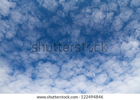 Dark blue sky and white fluffy clouds.