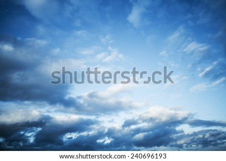 Dark blue sky with clouds, abstract nature background