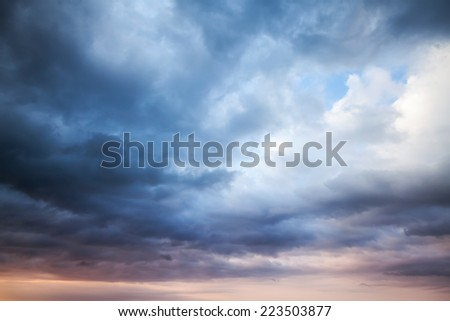 Dark blue stormy cloudy sky. Natural photo background #223503877