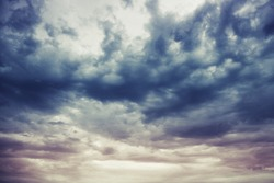 Dark blue stormy cloudy sky natural photo background with Instagram toned effect