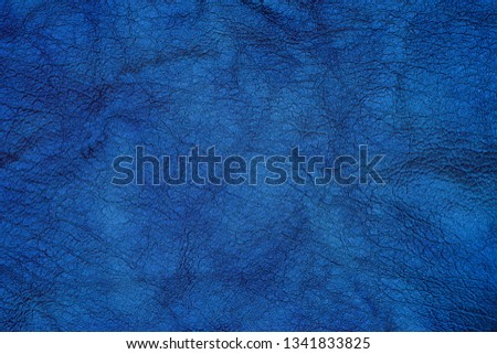 Dark blue textured leather background. Abstract leather texture.