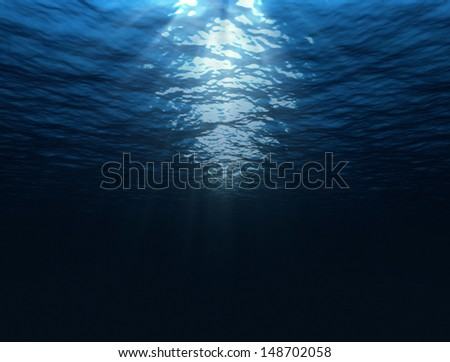dark blue under water image with sun rays