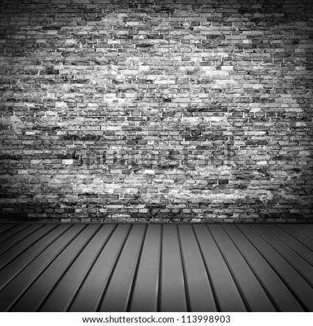 dark brick wall texture in basement house interior with beam of light and wooden floor, may use as grunge halloween background or night club advertising