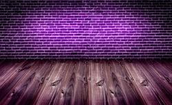 dark brickwall under purle light with wooden slats floor,night club background