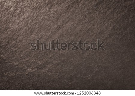 Dark bronze background of natural slate. Texture of brown stone closeup. Graphite backdrop macro #1252006348