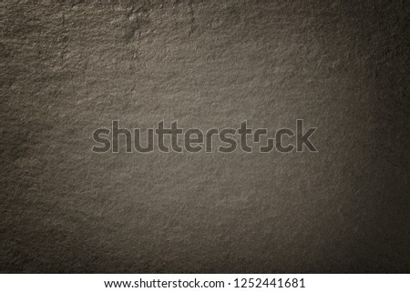 Dark bronze background of natural slate. Texture of brown stone closeup. Graphite backdrop macro #1252441681
