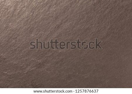 Dark bronze background of natural slate. Texture of brown stone closeup. Graphite backdrop macro #1257876637