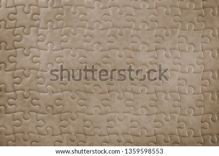 Dark bronze blank puzzle close up. Background and texture #1359598553