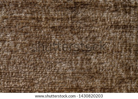 Dark brown background of soft, fleecy cloth. Texture of light bronze fluffy textile closeup. #1430820203