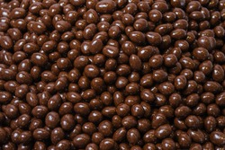 Dark brown dragee, chocolate covered nuts, background