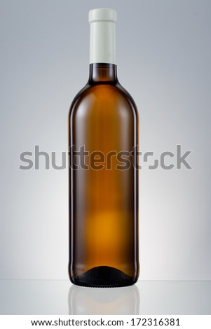 Dark brown glass bottle with white wine isolated #172316381