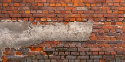 Dark brown, red old brickwork. Stone wall panorama. Exposed brickwork background, grunge texture. Wide banner, long wall with copy space for text.