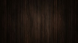 Dark Brown wood texture and background. Wooden table surface, top view in Vertical line