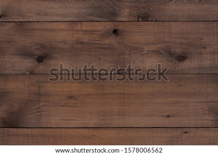 Dark brown wooden surface. Texture for background #1578006562