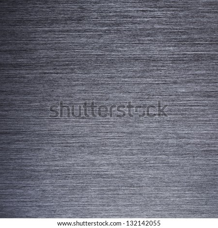 Dark brushed metal background. High resolution.