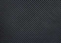 Dark bumpy plastic texture with copy space