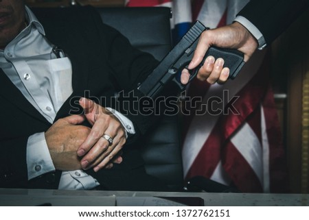 Dark business concept : Close up killers, use of guns to kill politicians or businessmen who hinder serious commercial interests
