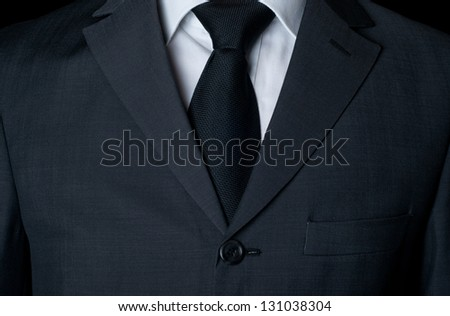 Dark business suit with a tie - stock photo