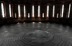 Dark castle tower round room interior with glowing windows. Ancient fortress (Kremlin) in Smolensk town, Russia