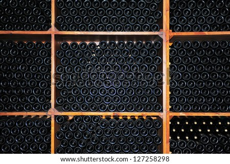 Dark cellar with old bottles of red wine