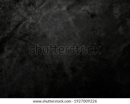 Dark cement wall background in vintage style for graphic design or wallpaper. The pattern of the concrete floor is aged in a retro concept.