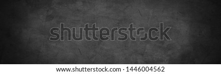 dark cement with horizontal chalkboard or chalkboard background and banner