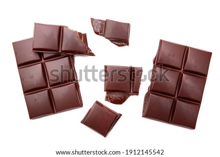Dark chocolate bar and cubes isolated on white backgroun, top view