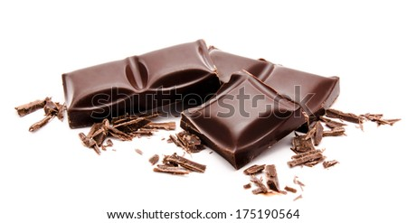 Dark chocolate bars stack with crumbs isolated on a white background