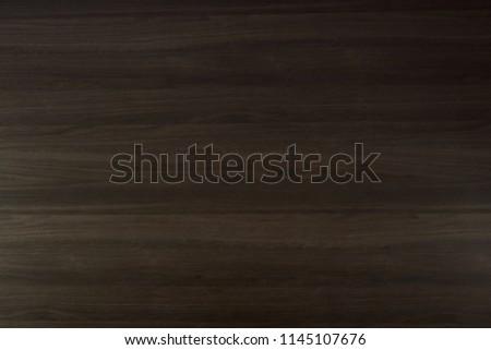 Dark chocolate brown wood texture surface background