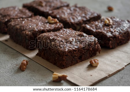 Dark chocolate brownie bars, pieces with walnuts #1164178684