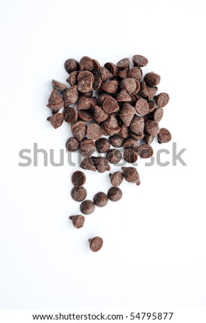 Dark chocolate chips on a white background. - stock photo