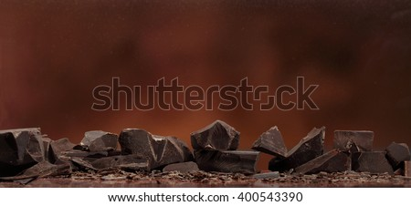 Dark chocolate / Chocolate chunks isolated / Chocolate bar pieces #400543390