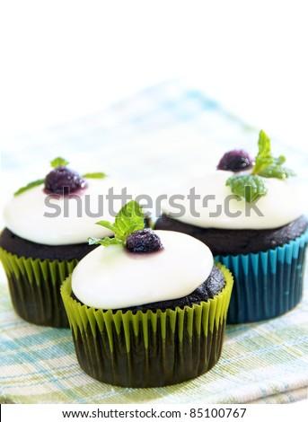 Dark chocolate cupcakes with white chocolate ganache frosting ...