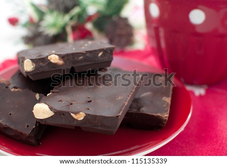 Dark chocolate with nuts close-up with christmas decor
