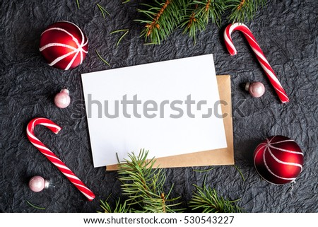 Dark christmas background with christmas decoration, christmas balls and christmas candy cane #530543227