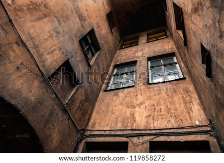 Dark closed square of living houses in old part of St.Petersburg, Russia